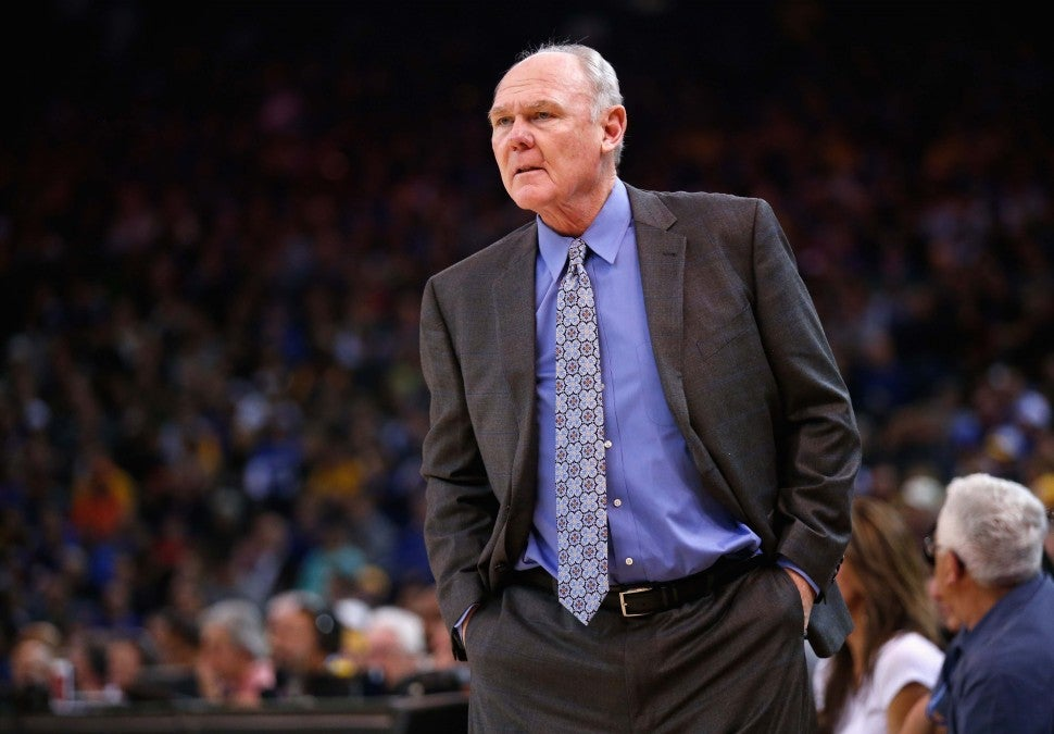 Head coach George Karl of the Sacramento Kings stands on the side of the court during their game against the Golden State Warriors at ORACLE Arena on December 28, 2015 in Oakland, California.