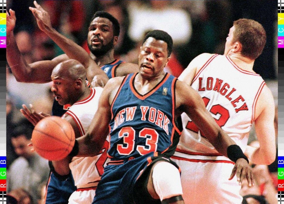 Patrick Ewing (C) holds back Chicago Bulls guard Michael Jordan (L) and Bulls Luc Longley (R) from grabbing a rebound as Knicks forward Charles Oakley (background) looks on in the first quarter 21 January at the United Center in Chicago, Illinois.