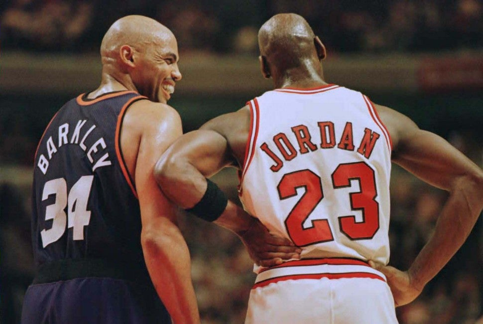 Charles Barkley (34) laughs at a foul call with Chicago Bulls guard Michael Jordan (23) in the first half 28 January 1996 at the United Center in Chicago.