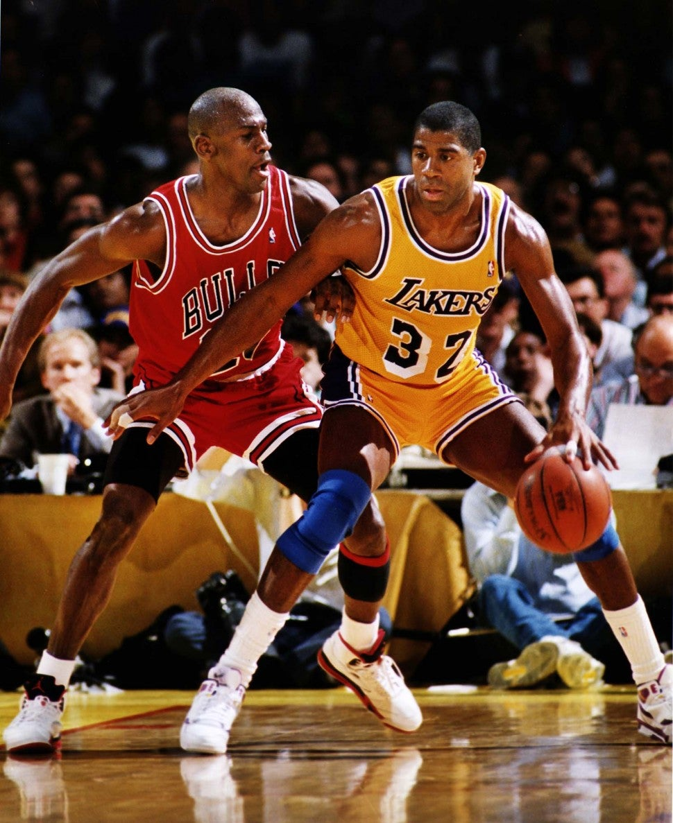 Los Angeles Lakers Magic Johnson, right, is guarded by Michael Jordan of the Chicago Bulls in the 1991 NBA Finals in Los Angeles.