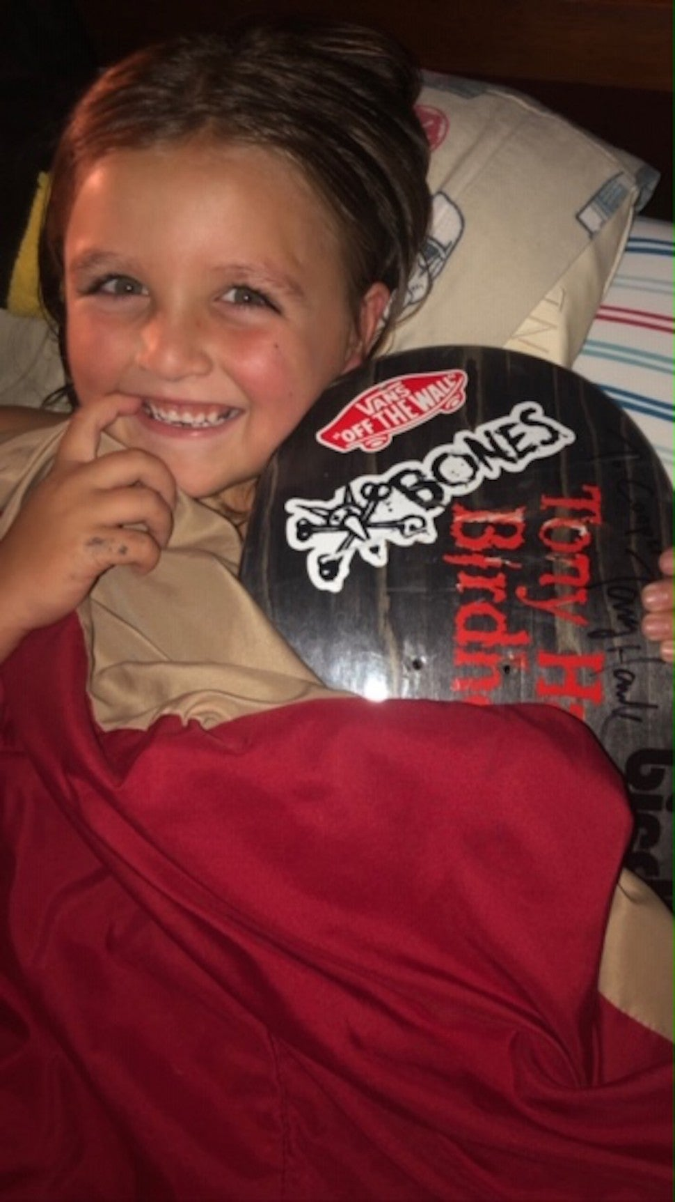 Cooper Morgan with Tony Hawk's skateboard