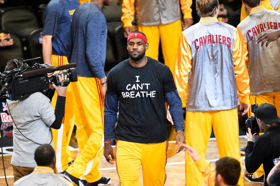 Cleveland Cavaliers forward LeBron James (23) wears a t shirt to honor Eric Garner as the team is introduced during a NBA game between the Cleveland Cavaliers and the Brooklyn Nets at Barclays Center in Brooklyn, NY The Cleveland Cavaliers defeated the Brooklyn Nets 110-88