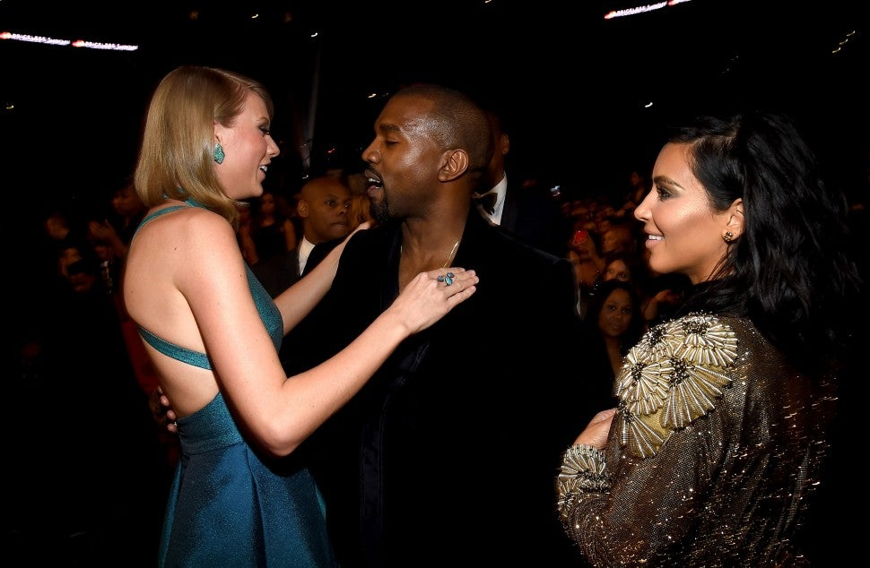 Taylor Swift, Kanye West and tv personality Kim Kardashian attend The 57th Annual GRAMMY Awards at the STAPLES Center on February 8, 2015 in Los Angeles, California.