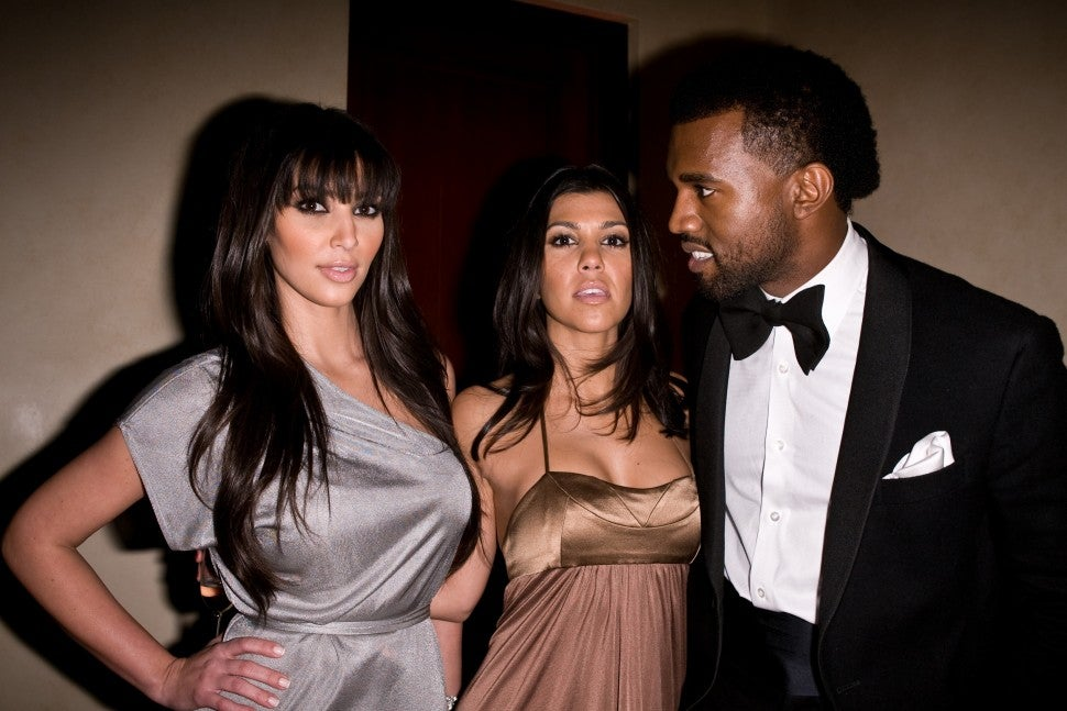 Kim Kardashian, Kourtney Kardashian and Kanye West at Flaunt Magazine's 10th Anniversary Party and Annual Holiday Toy Drive at the Wayne Kao Mansion on December 18th, 2008 in Holmby Hills, CA.
