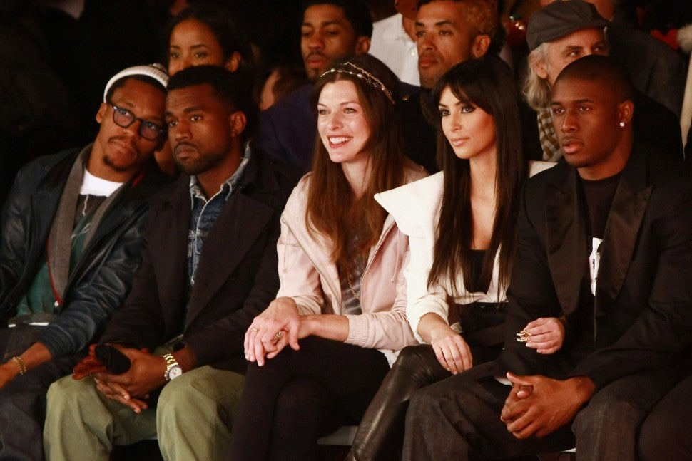 Lupe Fiasco, Kanye West, Milla Jovovich, Kim Kardashian and Reggie Bush attend Y-3 Fall 2009 during Mercedes-Benz Fashion Week at Pier 40 - West Street in West Houston Street on February 15, 2009 in New York City.