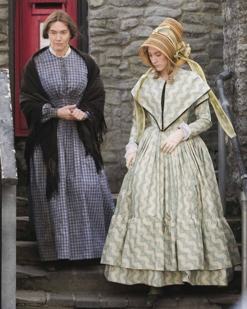 Kate Winslet and Saoirse Ronan on the set of new period drama 'Ammonite' on March 13, 2019 in Lyme Regis, England.