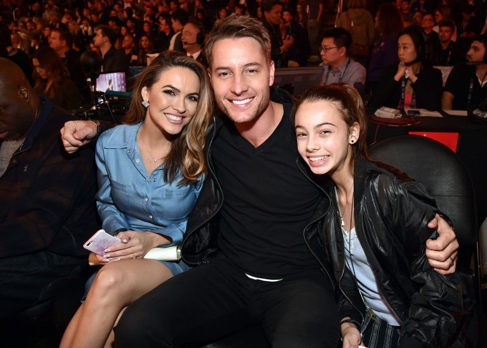 Chrishell Stause, Justin Hartley and Isabella Justice Hartley attend the 2018 State Farm All-Star Saturday Night at Staples Center on February 17, 2018 in Los Angeles, California.