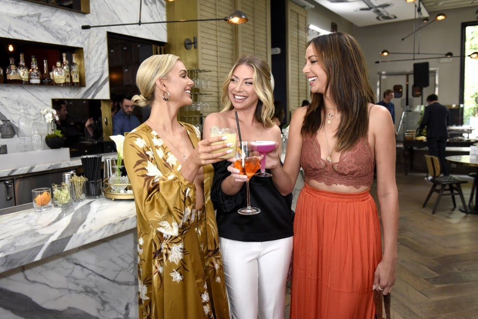 Lala Kent cheers with Stassi Schroeder and Kristen Doute at an event in 2019.