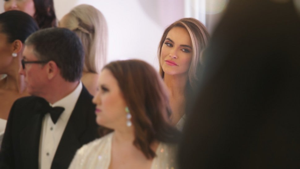 Chrishell Stause sits in the crowd of Christine Quinn's wedding on 'Selling Sunset.'