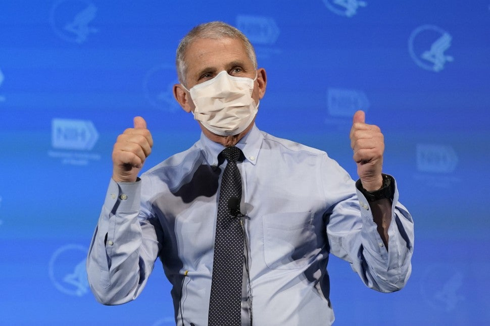 Anthony Fauci, director of the National Institute of Allergy and Infectious Diseases, gestures after receiving the Moderna Inc. Covid-19 vaccine during an event at the NIH Clinical Center Masur Auditorium in Bethesda, Maryland, U.S., on Tuesday, Dec, 22, 2020.