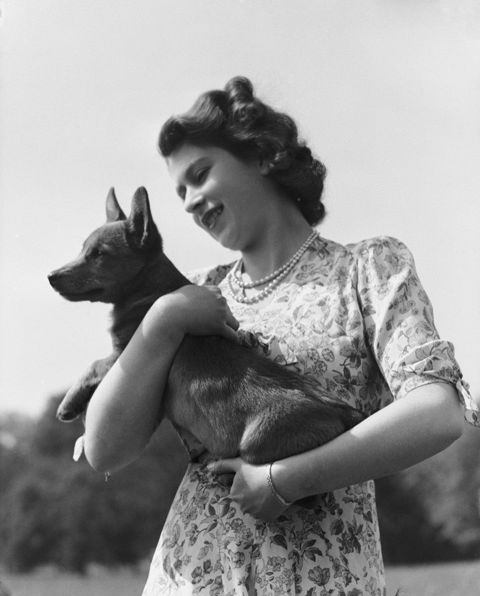 Queen Elizabeth with her pet Corgi Sue or Susan at Windsor Castle, UK, 30th May 1944