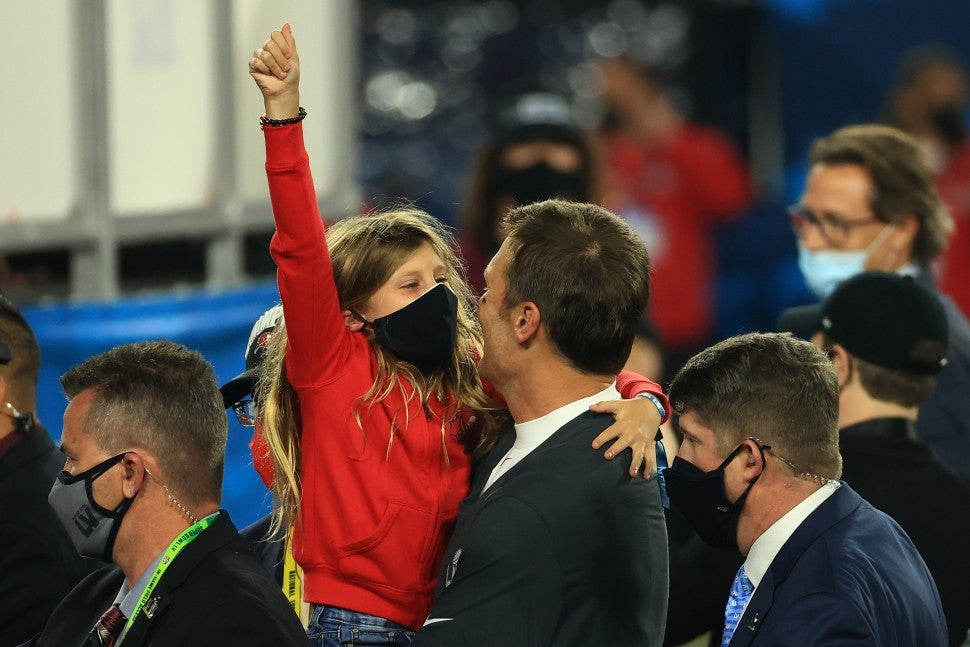 Tom Brady #12 of the Tampa Bay Buccaneers celebrates with his daughter Vivian Brady after defeating the Kansas City Chiefs in Super Bowl LV at Raymond James Stadium on February 07, 2021 in Tampa, Florida.