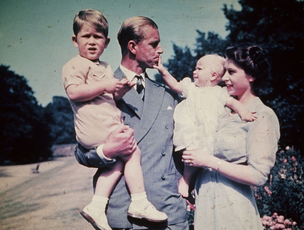 Prince Charles, Prince Philip, Princess Anne, and Queen Elizabeth