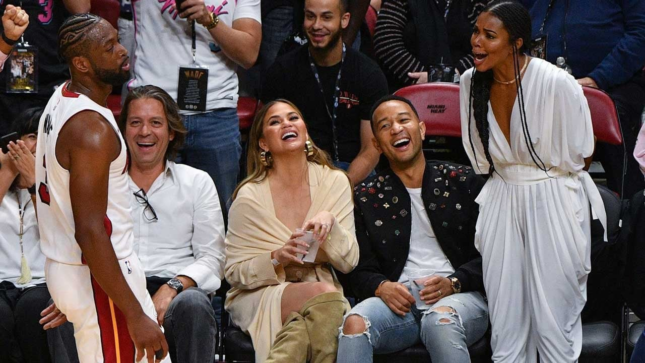 Dwyane Wade Hilariously Falls on Chrissy Teigen and John Legend During Final Game in Miami