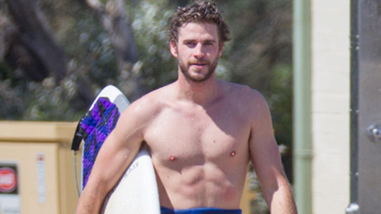 liam hemsworth strips down and takes a hot shower after