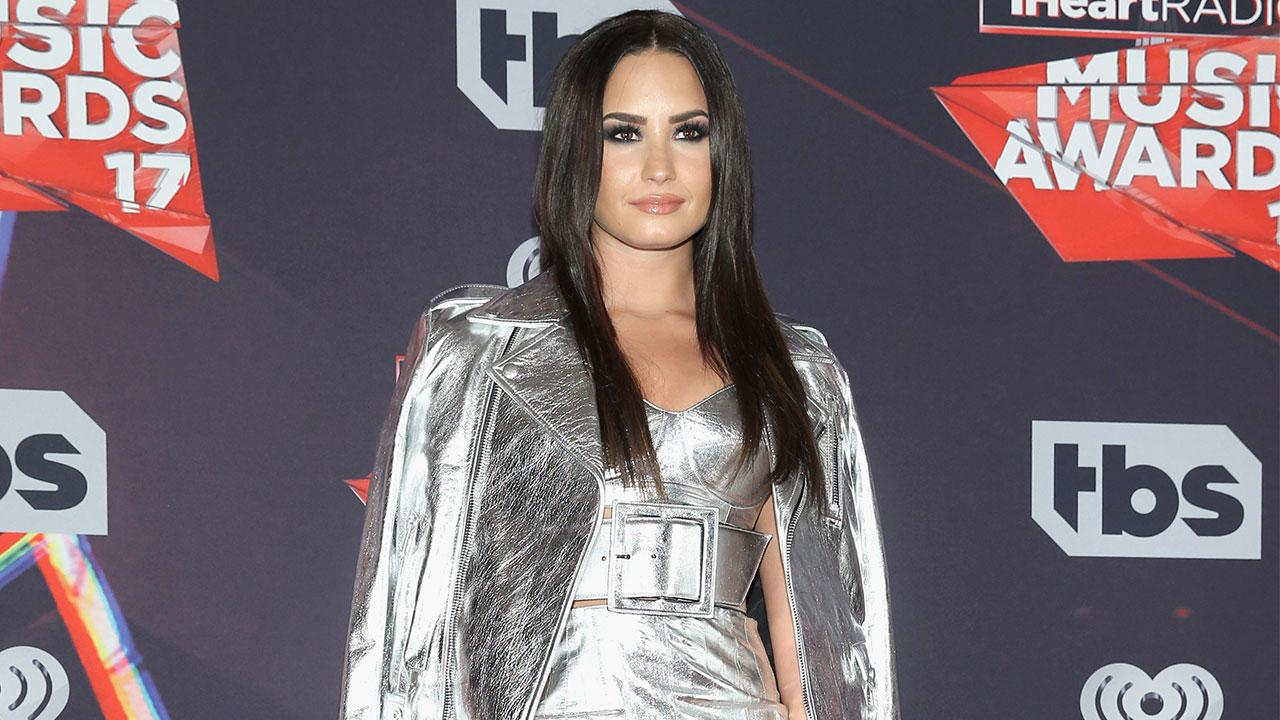 Demi Lovato Slays In Silver Shows Off Her Bare Legs On