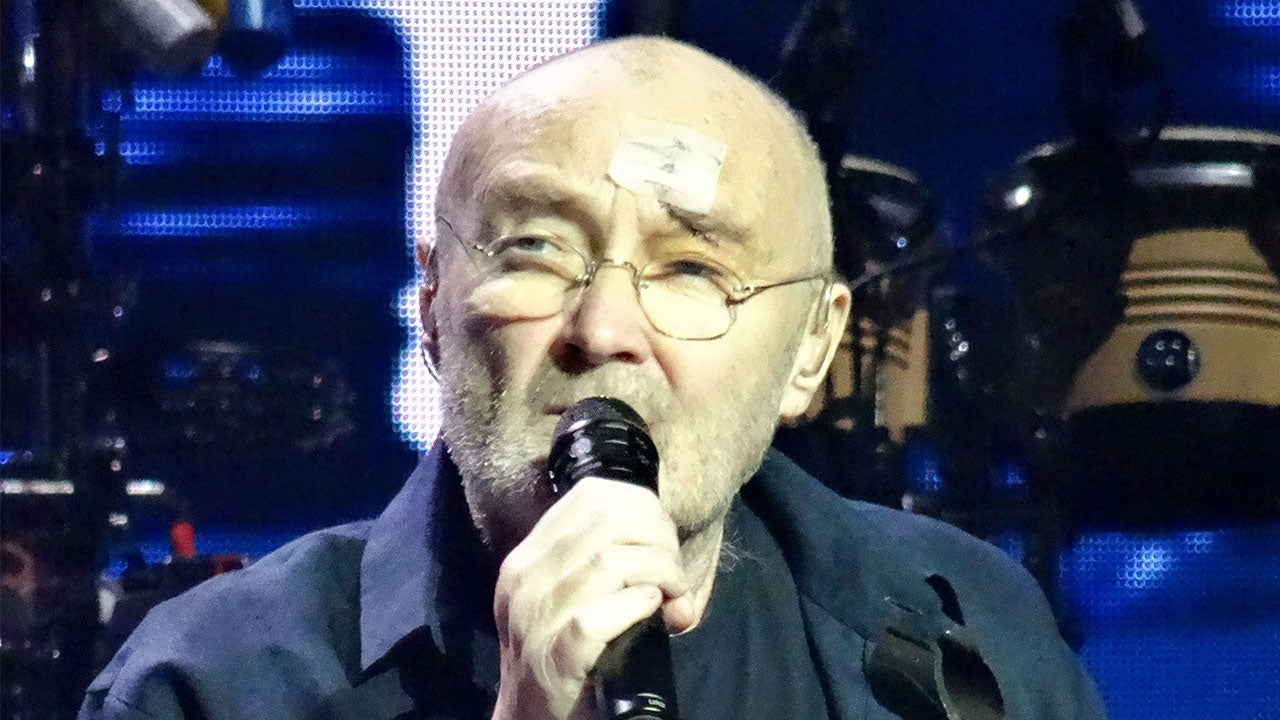phil collins returns to stage with bandage on head after being hospitalized for  u0026 39 severe gash