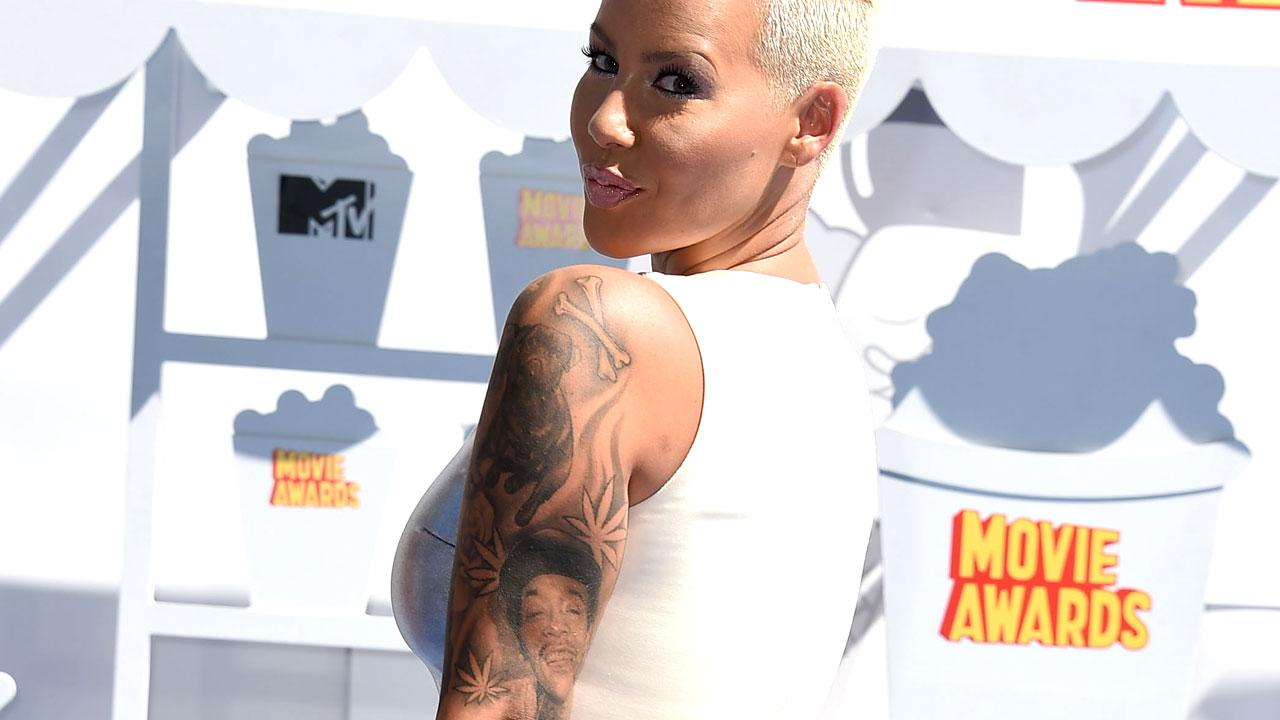 Amber Rose Covers Up Her Wiz Khalifa Tattoo With Another Man\'s F ...