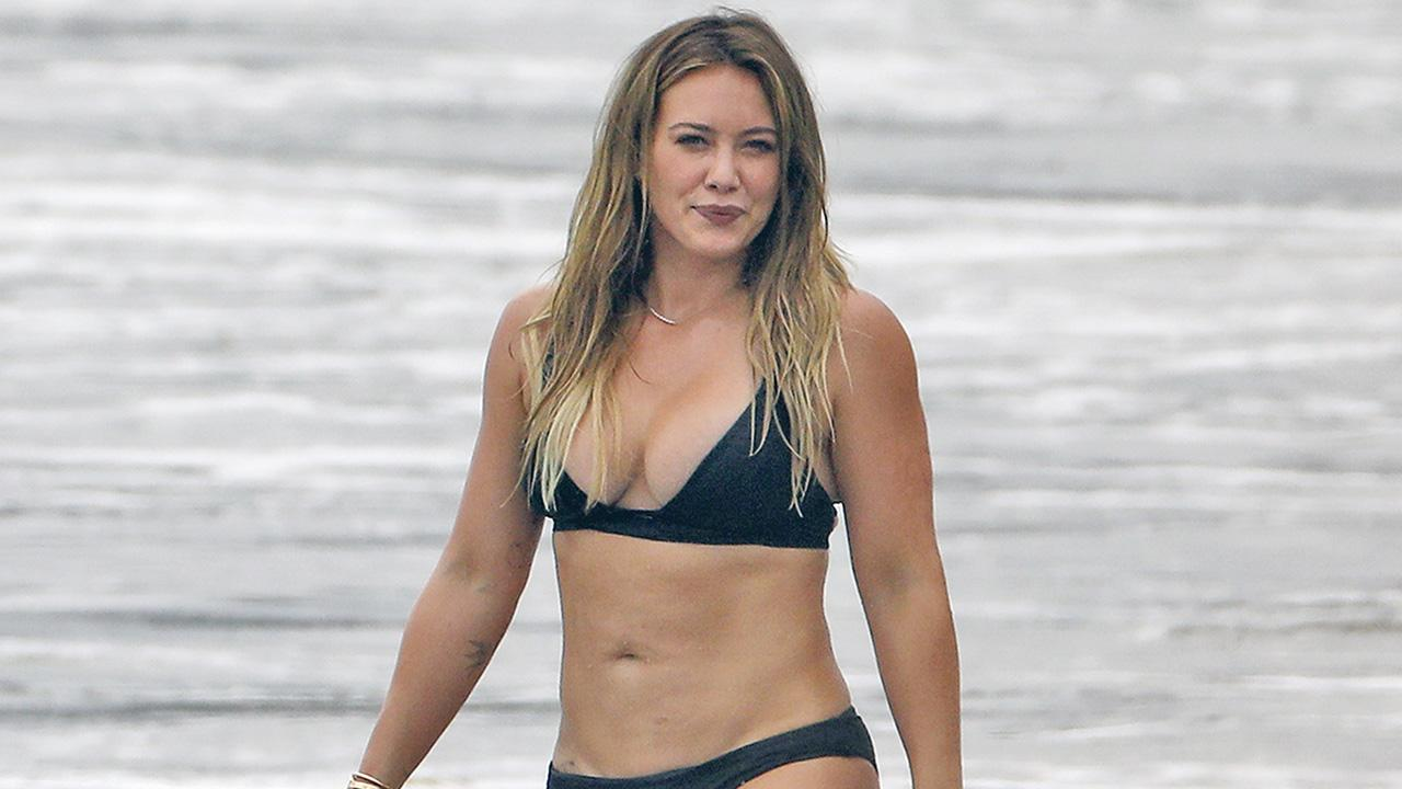 Hilary Duff Slays in a Black Bikini While Enjoying a Beach Day With Her Ex Mike Comrie and Son Luca: Pics! | Entertainment Tonight