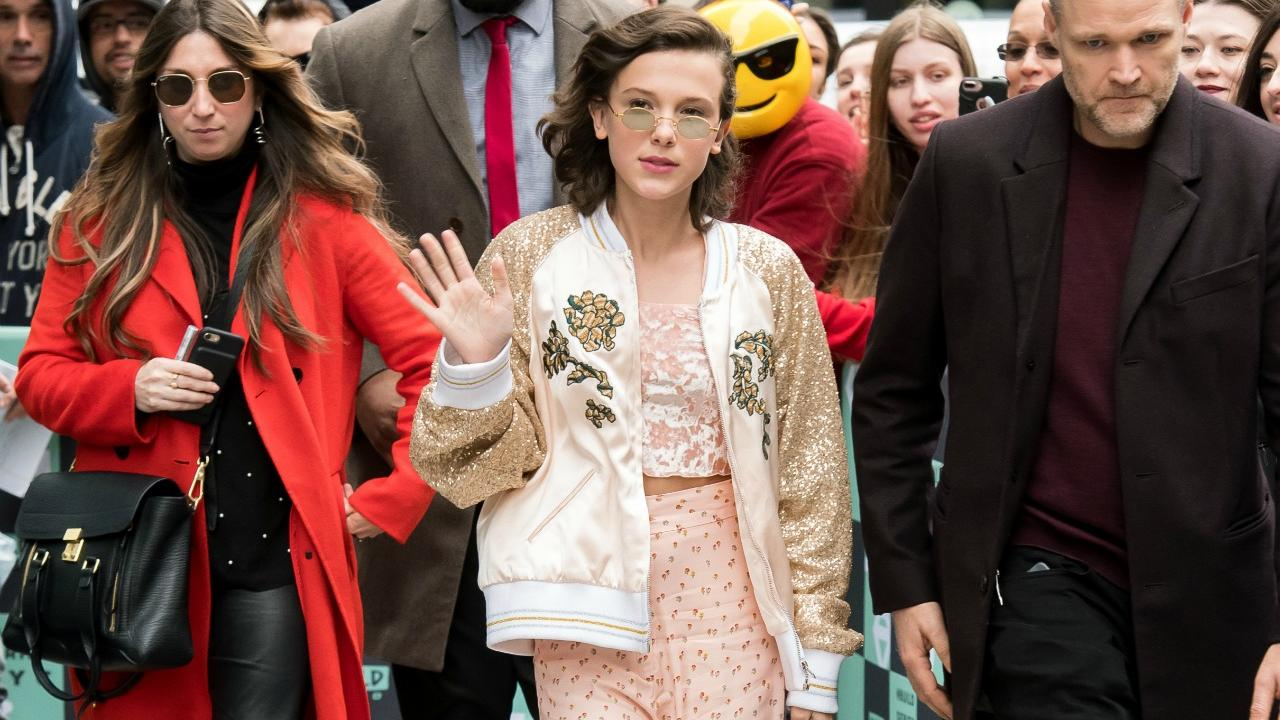 millie bobby brown dazzles in 2 fashionable outfits in new