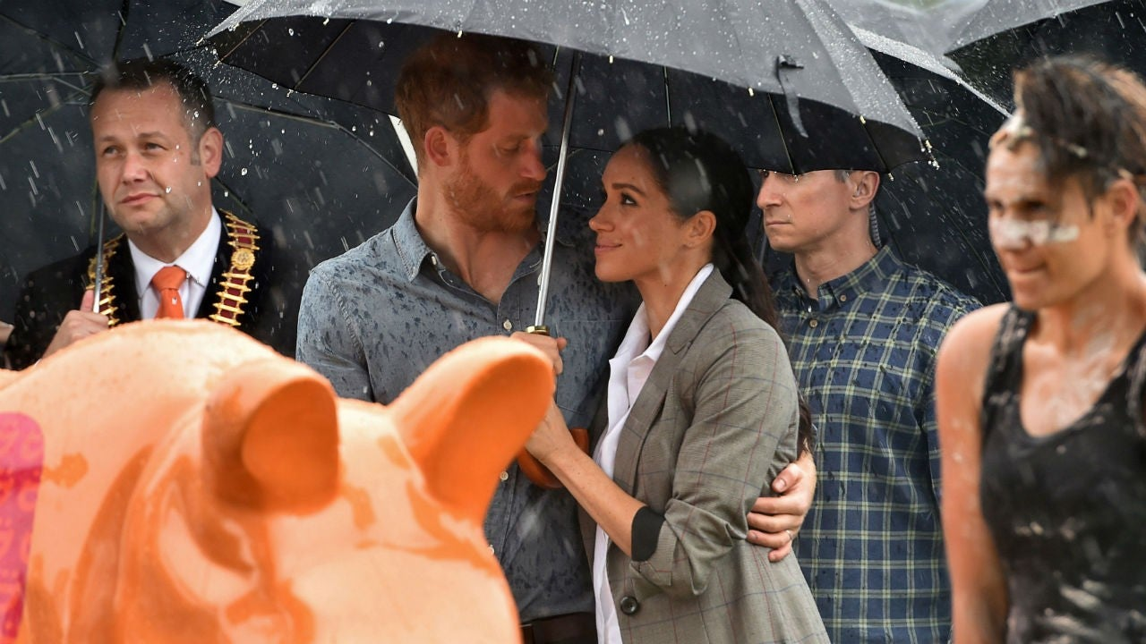These Pics of Meghan Markle and Prince Harry Cuddling in the Rain Prove True Love Exists