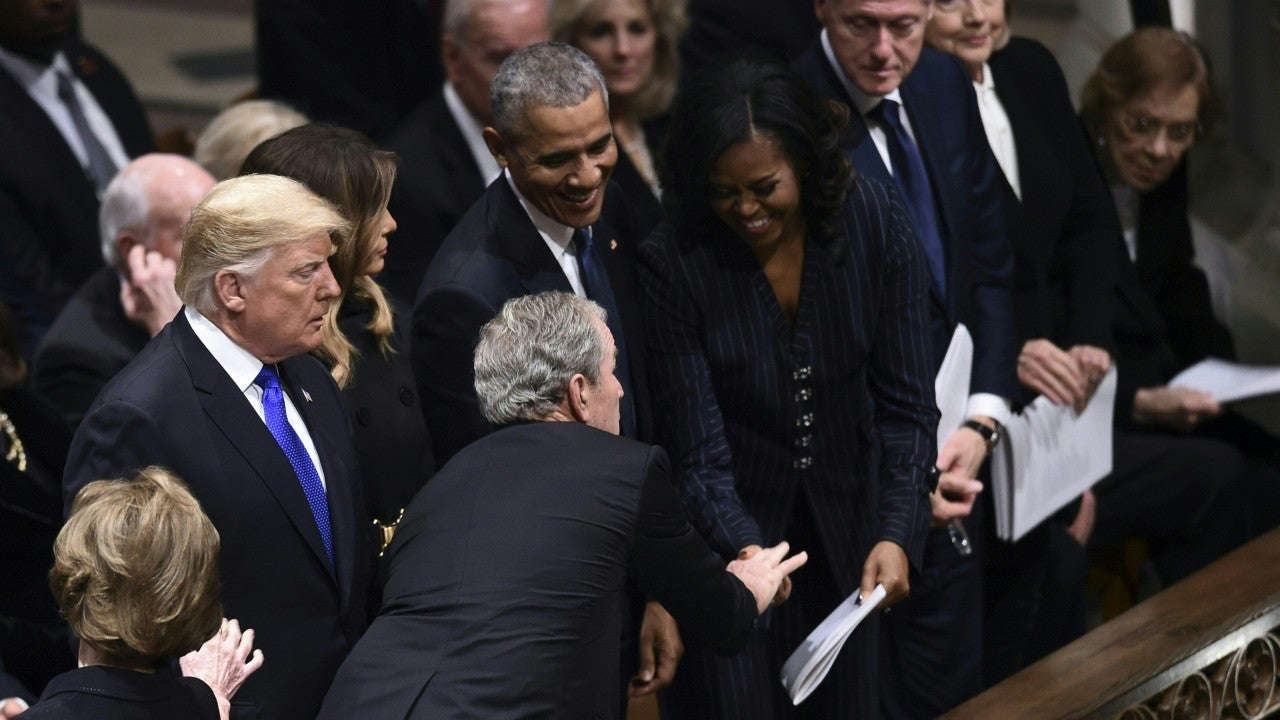 George W. Bush Greets Michelle Obama With Candy at Father's Funeral