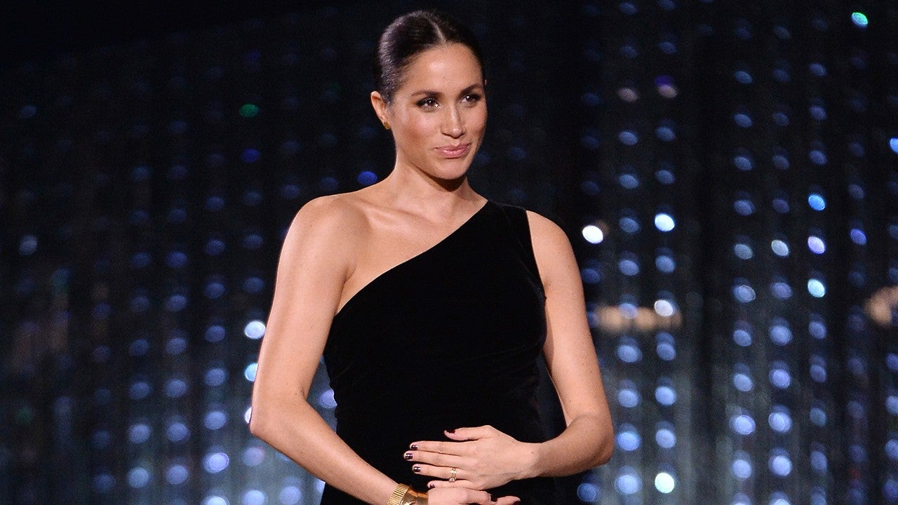 Meghan Markle Cradles Growing Baby Bump As She Honors Her