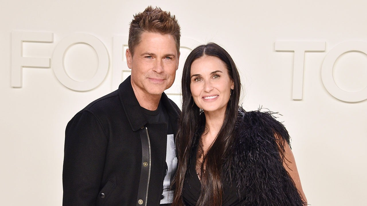Demi Moore and Rob Lowe Share a Kiss at Fashion Show