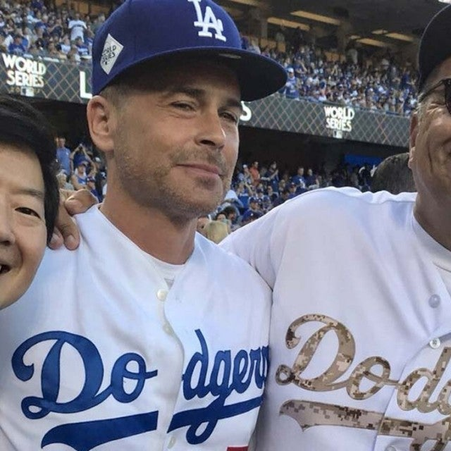 Ken Jeong, Rob Lowe and George Lopez at Dodger Stadium during Game 1 of the World Series