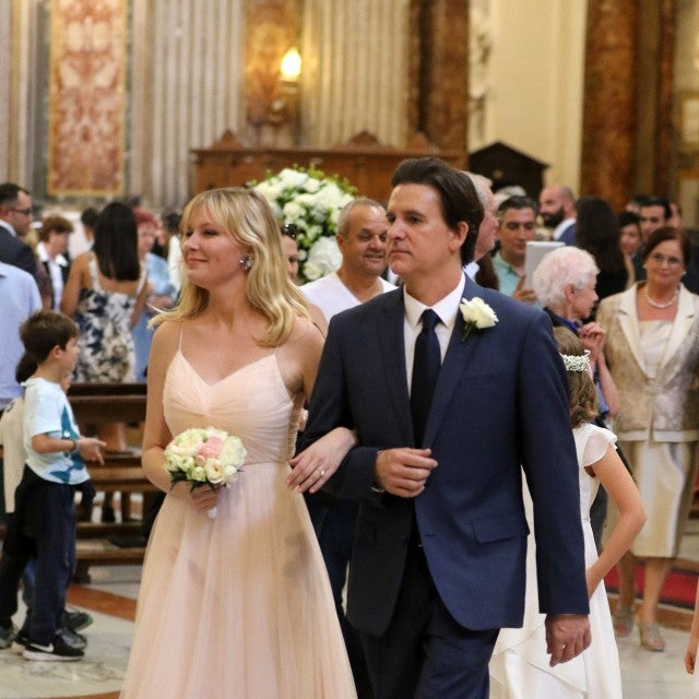 Kirsten Dunst is a bridesmaid at her friend's wedding in Rome.