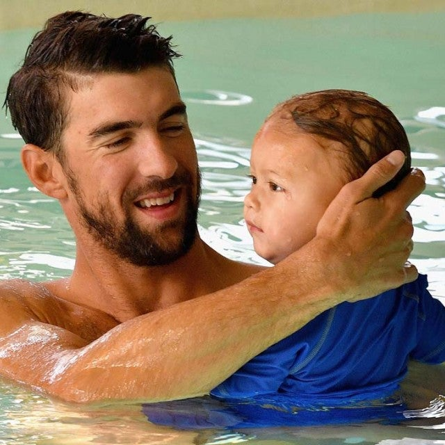 Michael Phelps swims in a pool with son Boomer.