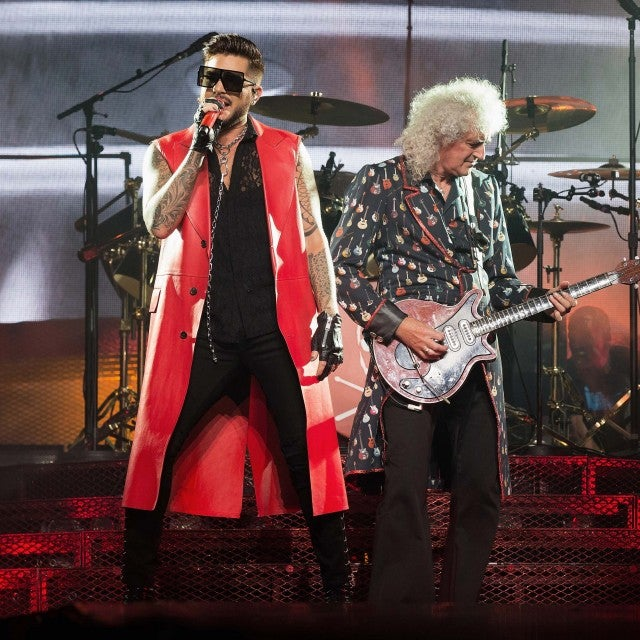 Adam Lambert and Brian May perform on stage at the O2 Arena in London, England, on July 1.