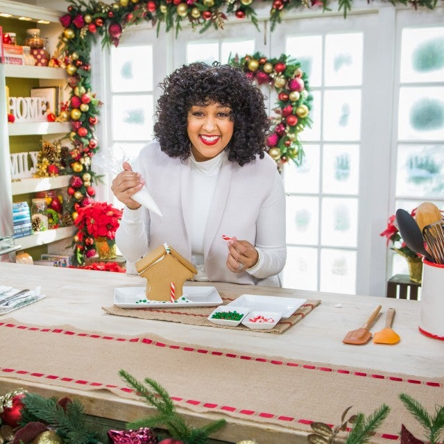 Tia Mowry builds a gingerbread house
