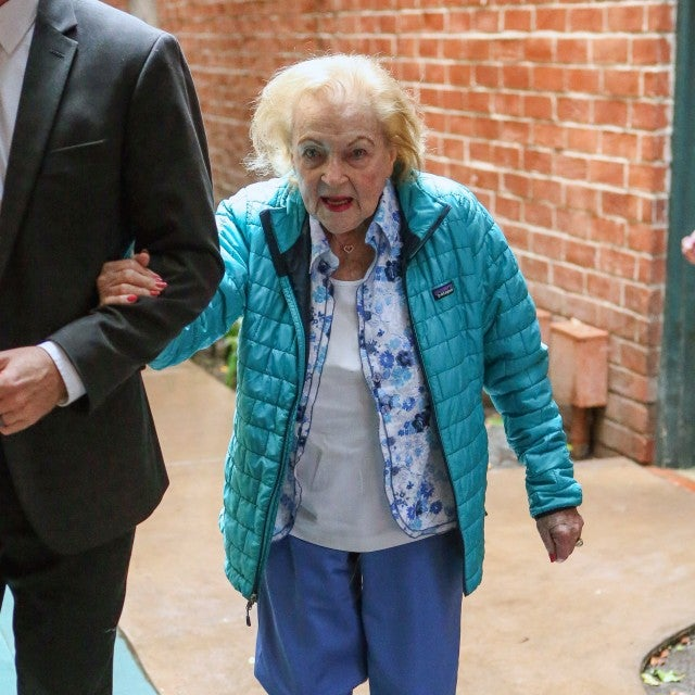 A beaming Betty White looks happy and healthy as she runs errands the day before her 97th birthday.