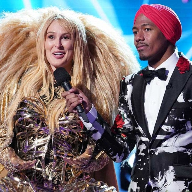 Rumer Willis as The Lion and host Nick Cannon on Fox's 'The Masked Singer'