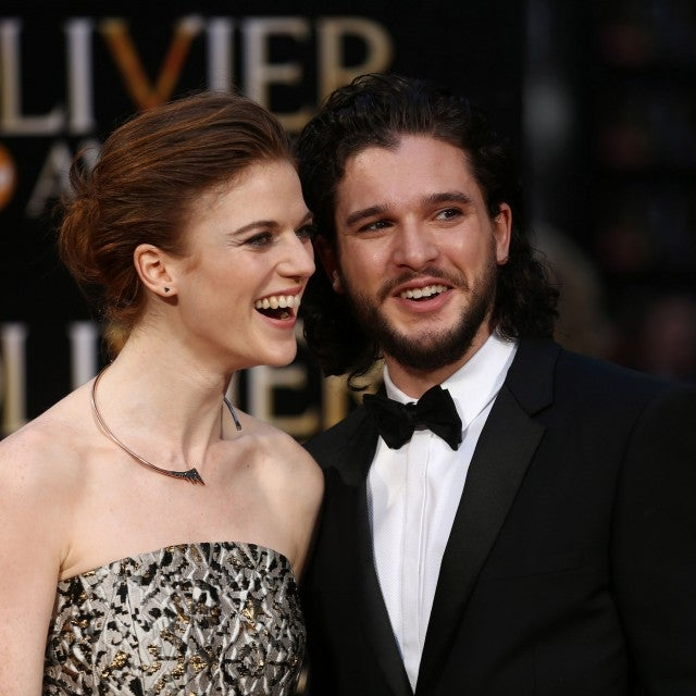 Kit Harington and Rose Leslie pose on the red carpet upon arrival to attend the 2016 Laurence Olivier Awards in London on April 3, 2016.