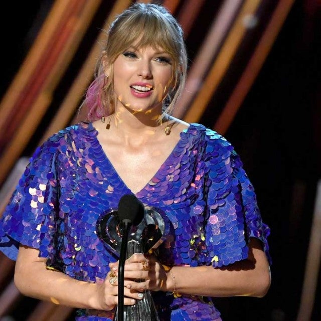 Taylor Swift accepts an award at the 2019 iHeartRadio Music Awards