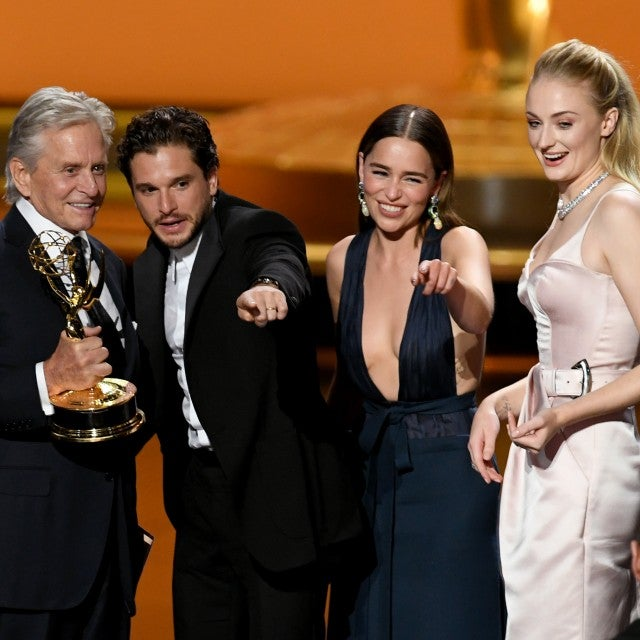 Game of Thrones cast members Kit Harrington, Emilia Clarke and Sophie Turner accept an award from Michael Douglas at the 2019 Emmys.