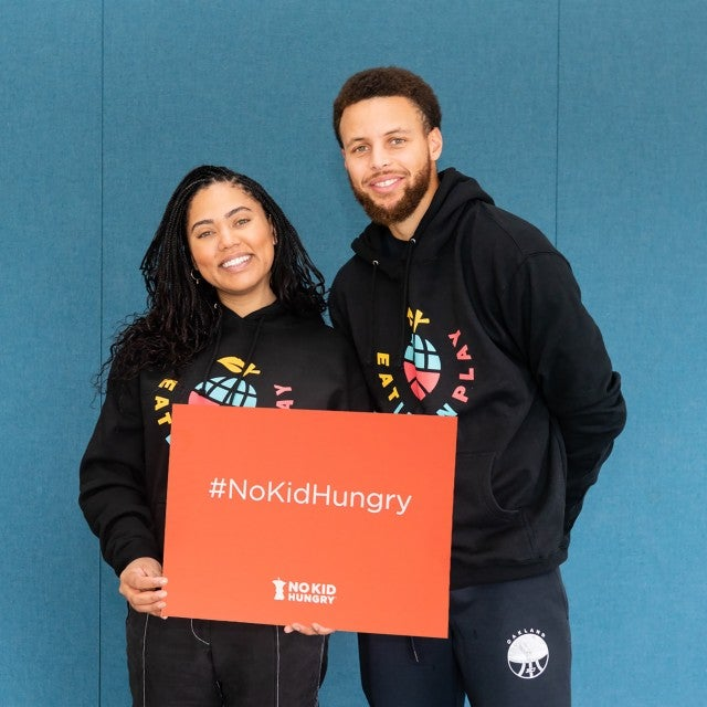 Steph and Ayesha Curry with Eat. Learn. Play. Foundation