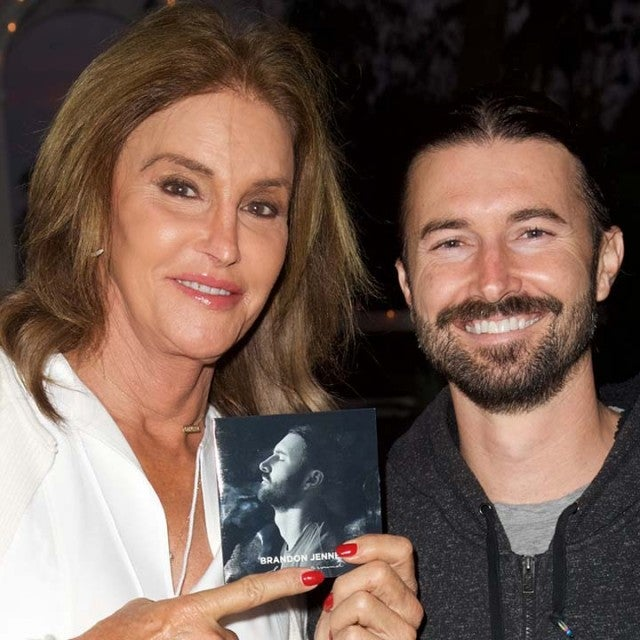 "Caitlyn Jenner and Brandon Jenner pose for a photo at the Brandon Jenner Record Release Party For ""Burning Ground"" on November 19, 2016 in Malibu, California."
