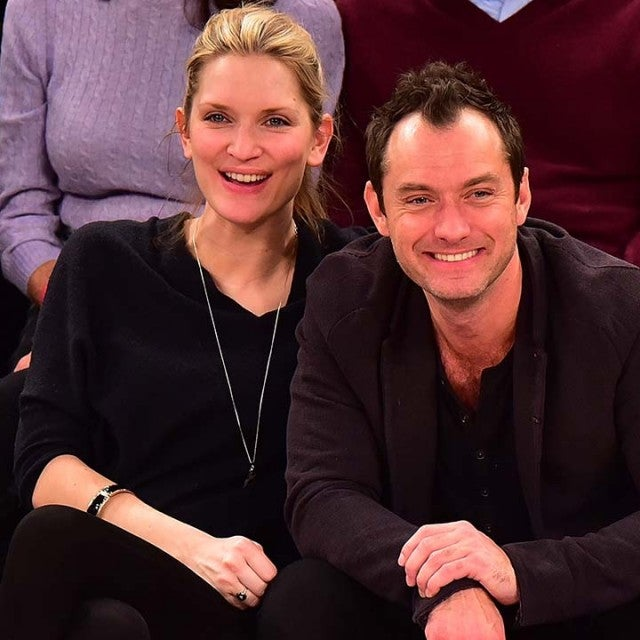 Phillipa Coan and Jude Law attend the Orlando Magic vs New York Knicks game at Madison Square Garden on February 26, 2016 in New York City.