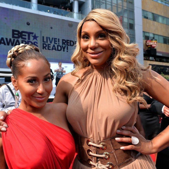 Recording artists Adrienne Bailon (L) and Tamar Braxton attend the P&G Red Carpet Style Stage at the 2013 BET Awards at Nokia Theatre L.A. Live on June 30, 2013 in Los Angeles, California.