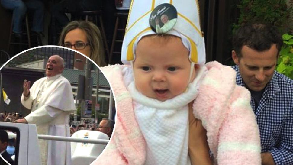 pope francis couldn t stop laughing as he blessed a baby dressed in