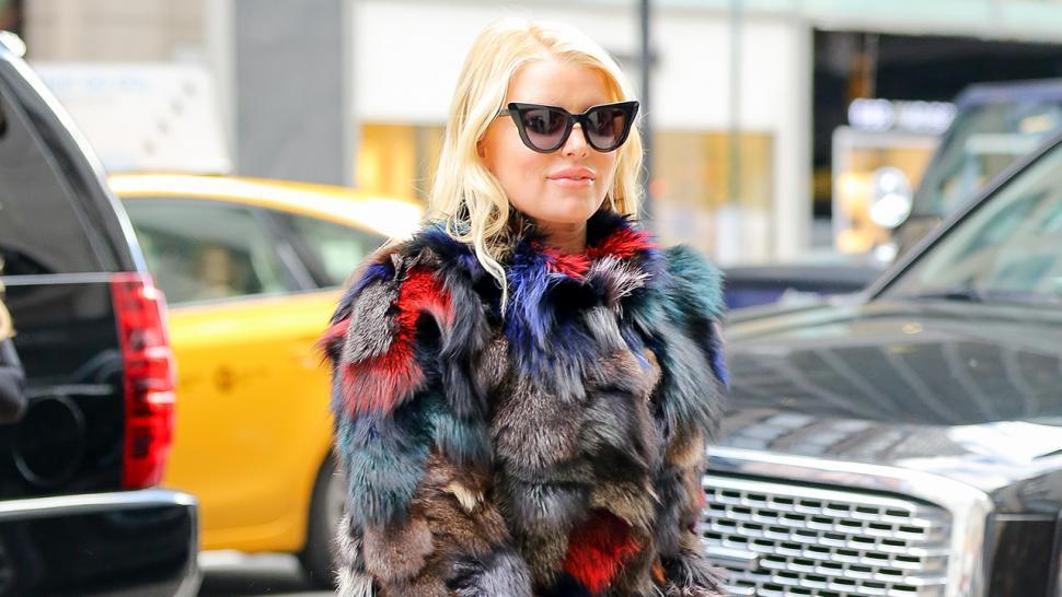 Jessica Simpson Sports Bizarre Colored Fur Coat And Giant