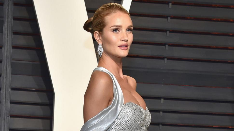 76cc700ae18 Rosie Huntington-Whiteley Shows Off Baby Bump on  Vanity Fair  Oscar Party  Red Carpet -- See the Pics!