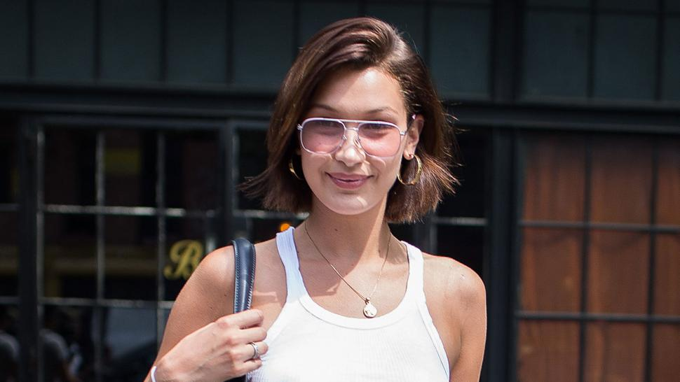bella hadid beats the heat by going braless again in new