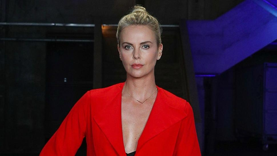 Charlize Theron Looks Red Hot At Atomic Blonde Event In