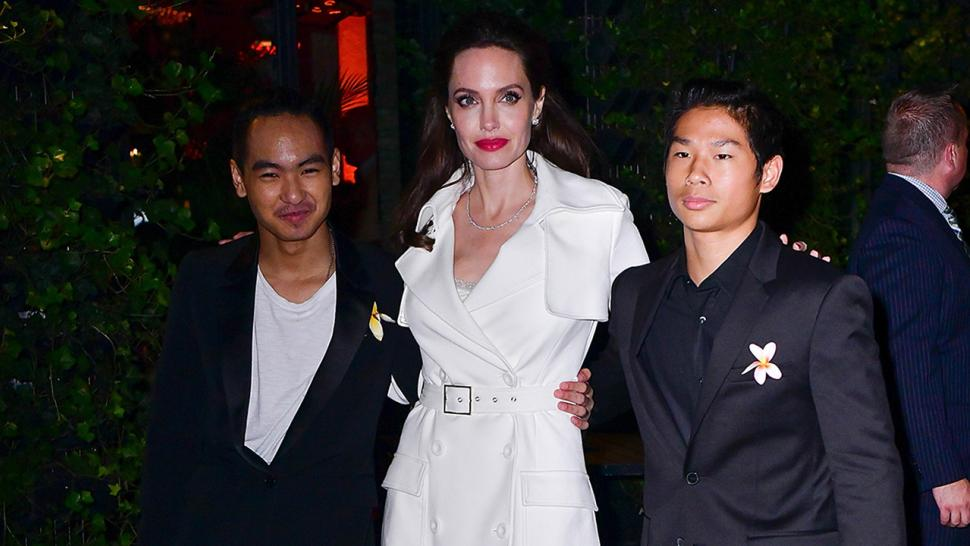 Angelina Jolie poses with sons Maddox and Pax