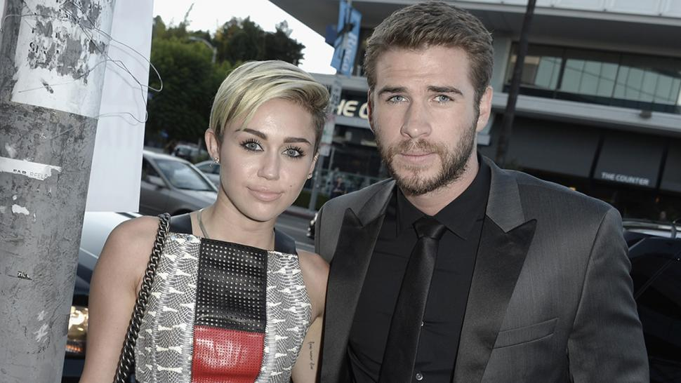 Miley Cyrus and Liam Hemsworth pack on PDA