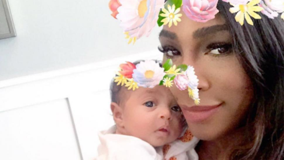 Serena Williams cuddles with her daughter Alexis